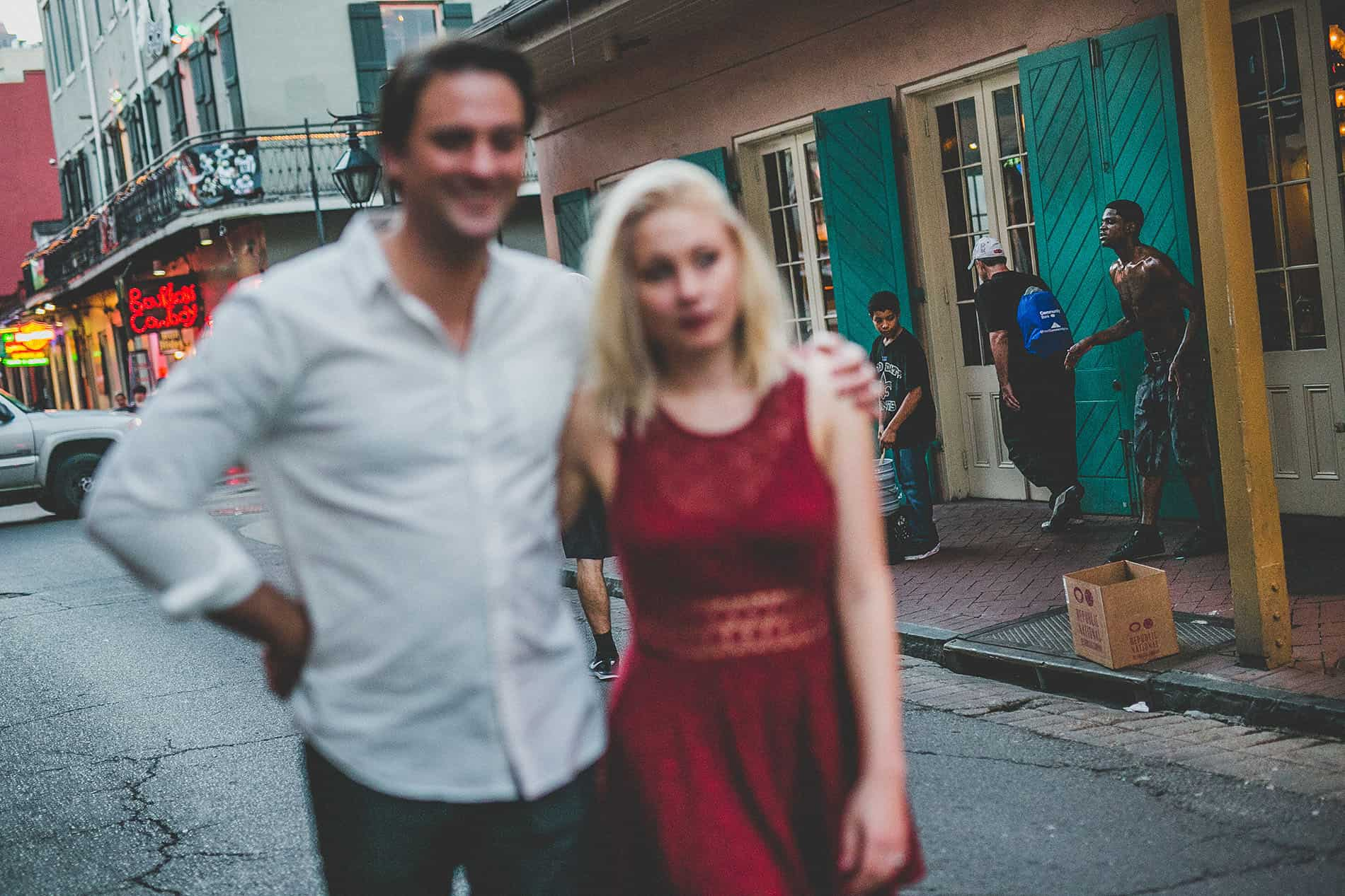 couple walking in the streets of new orleans for a photoshoot