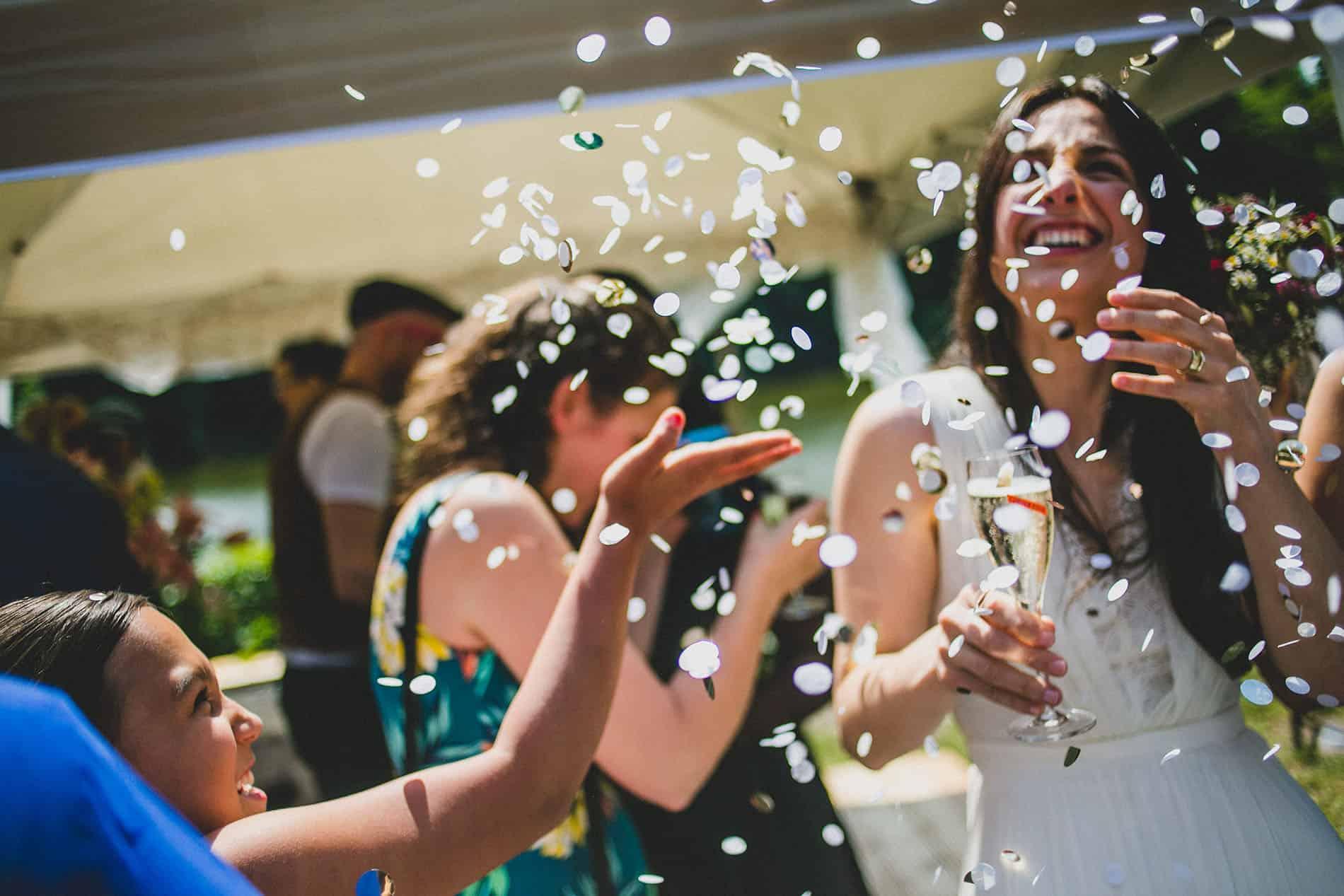 petals falling over a happy bride in her berlin wedding