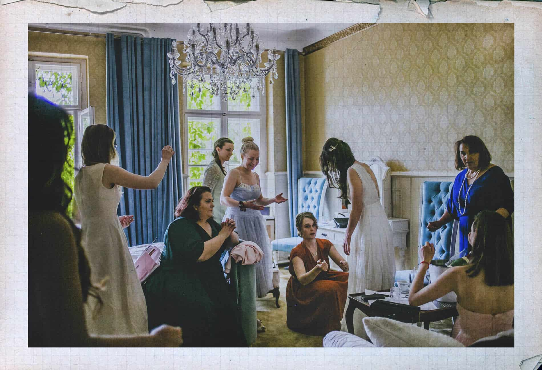 bride surrounded by friends and family before the ceremony in a berlin wedding