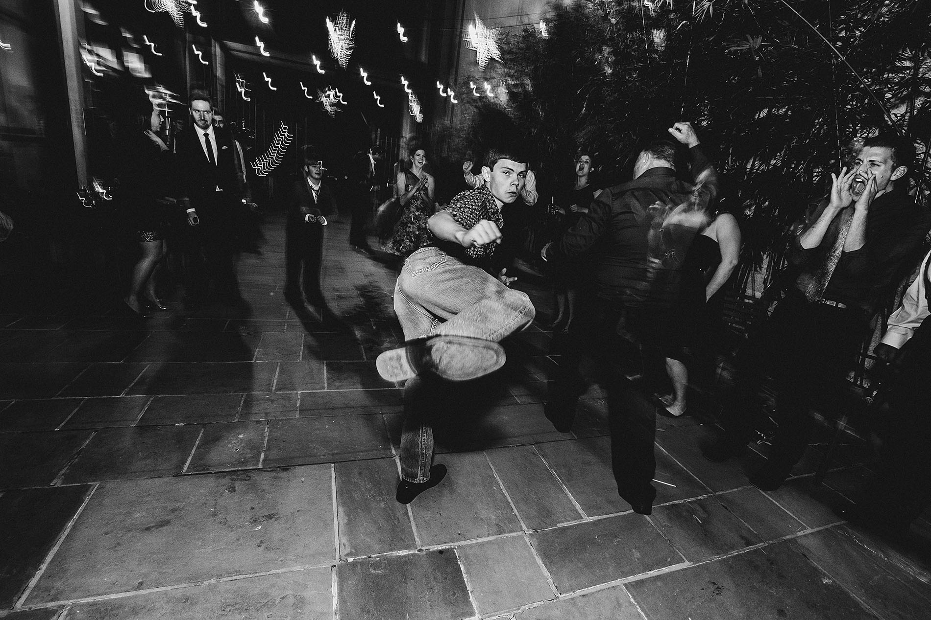 boy Kicking and dancing in a wedding