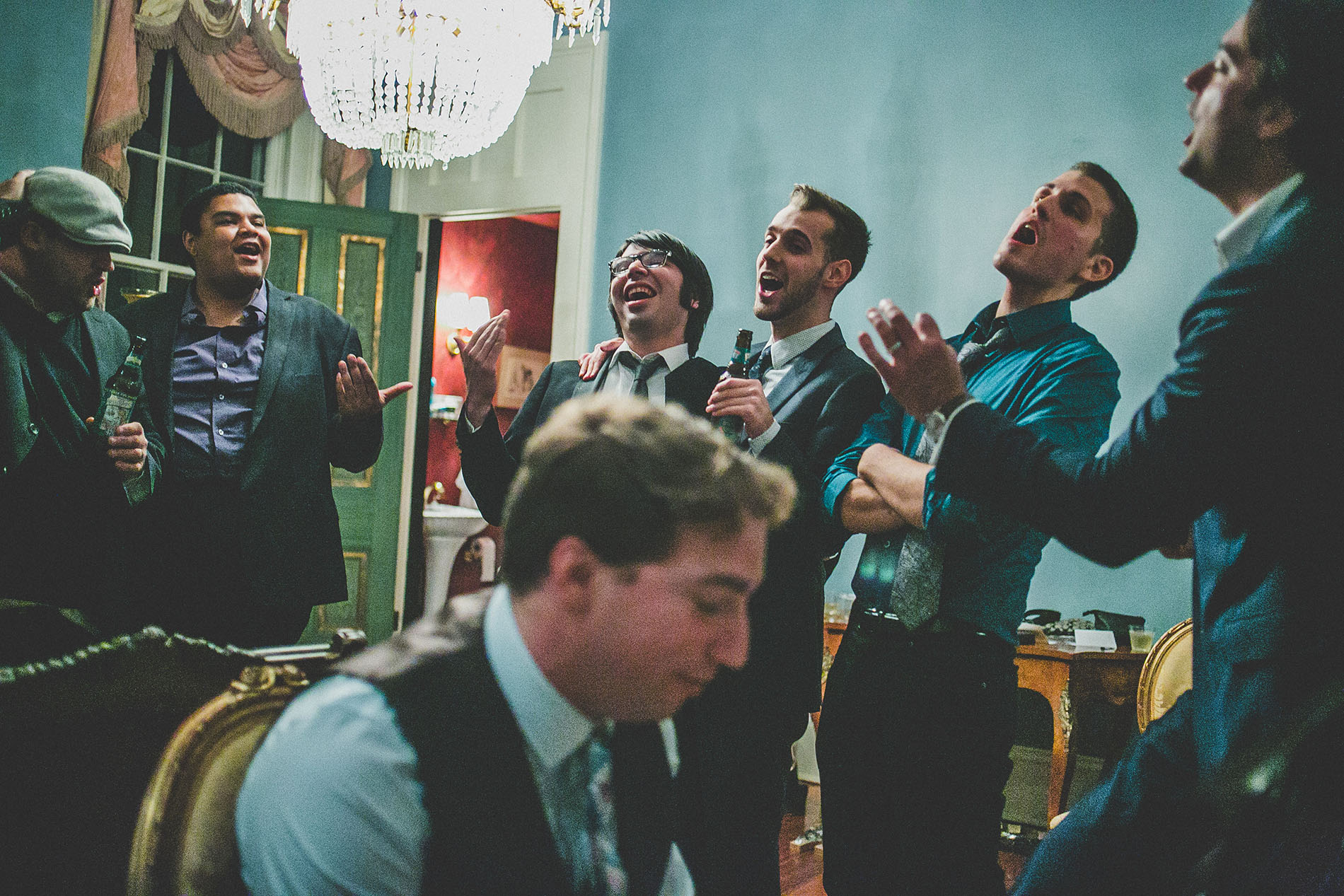 groom singing with his friends in a mansion in new orleans