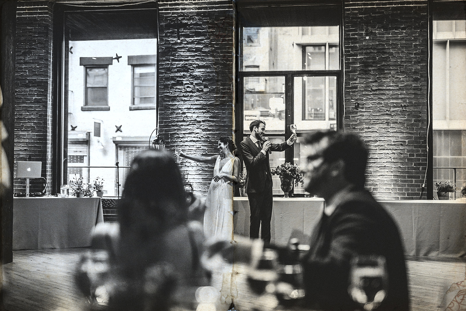 bride and groom`s toast in dumbo loft wedding
