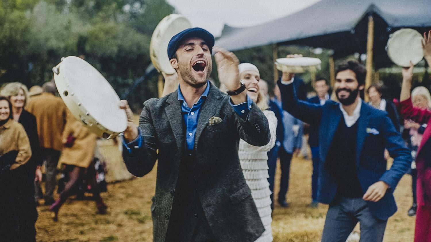 groom and bride playing the tambouring in their boho wedding