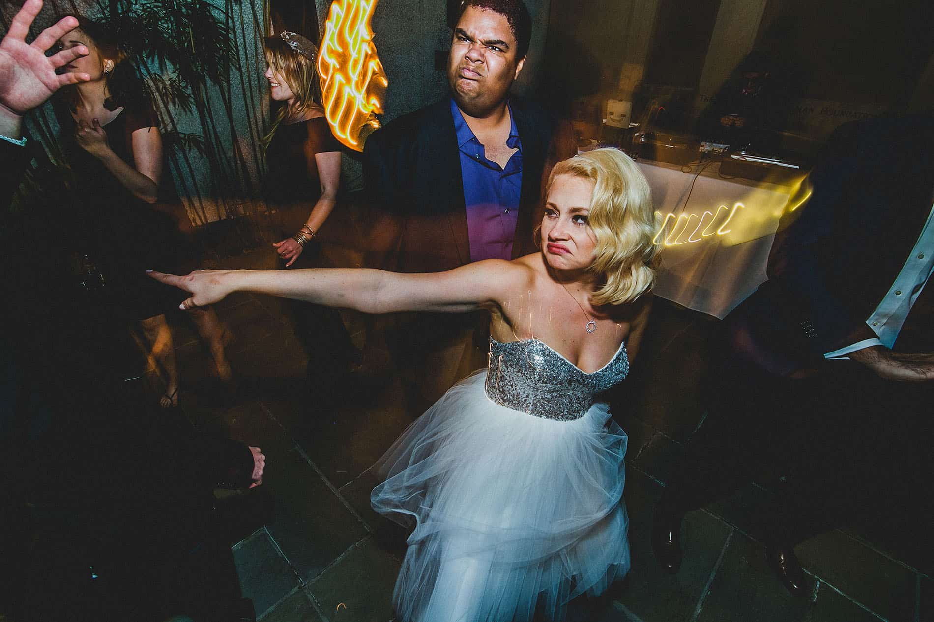 bride dancing in the dance floor pointing people