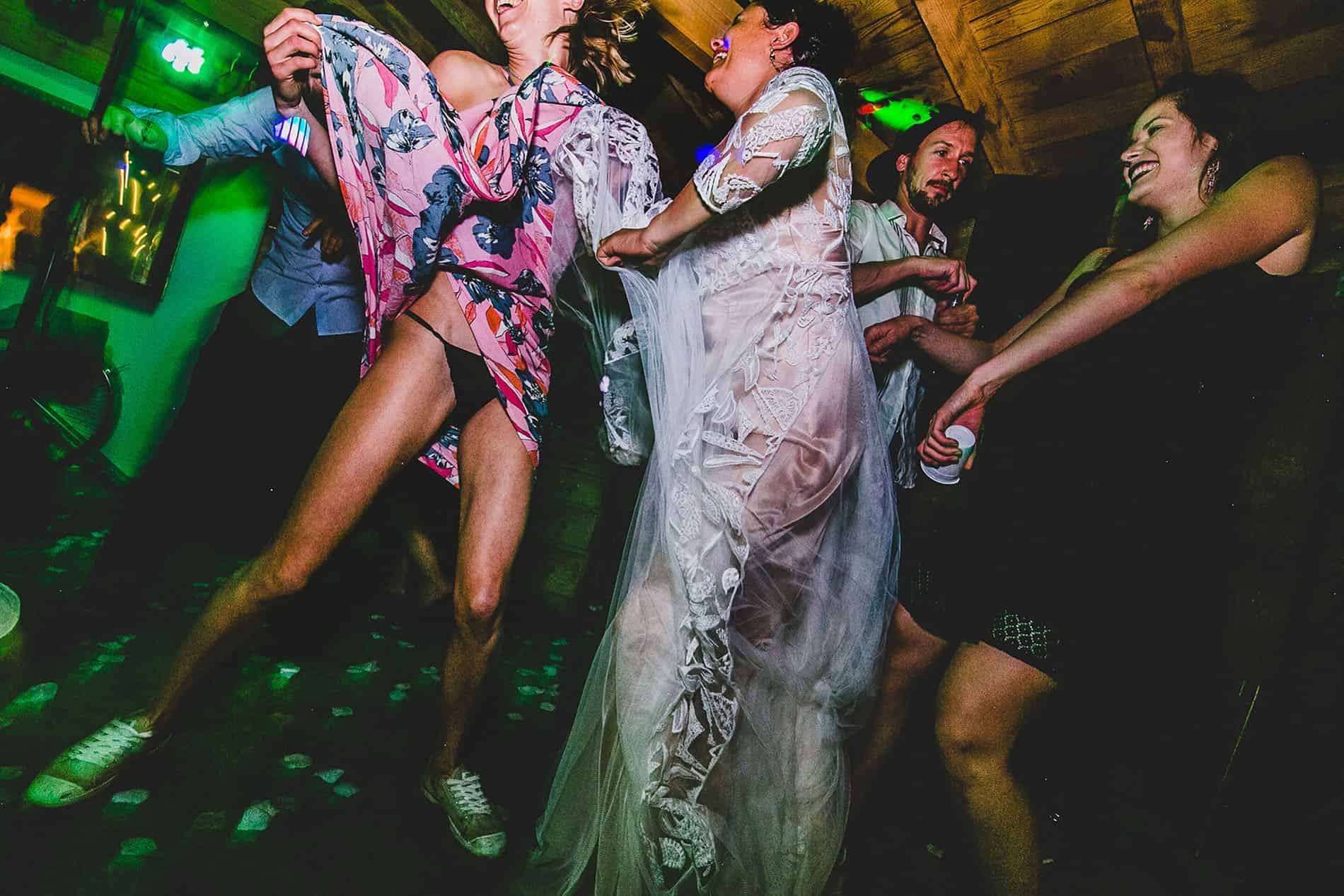crazy people dancing wild in french wedding