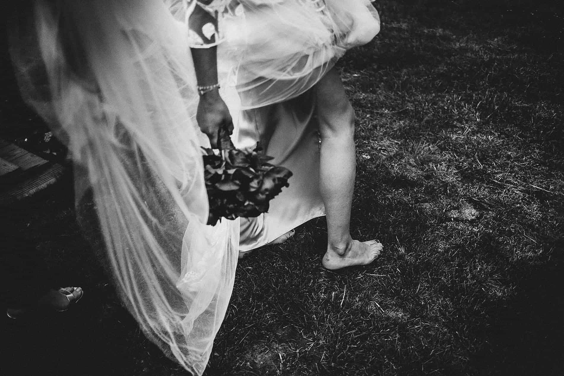 bride`s foot and bouquet