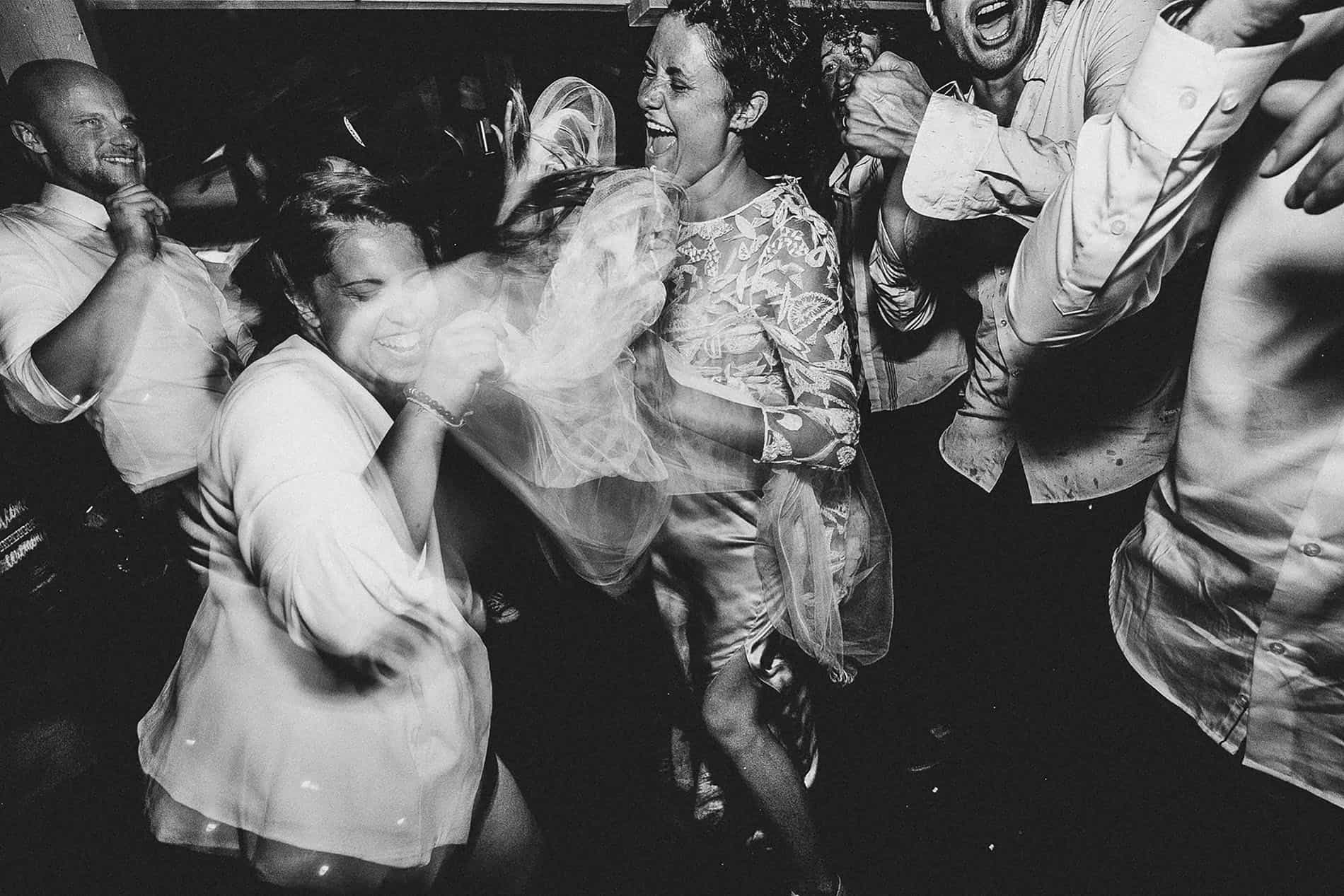wild bride dancing crazy in her wedding in france
