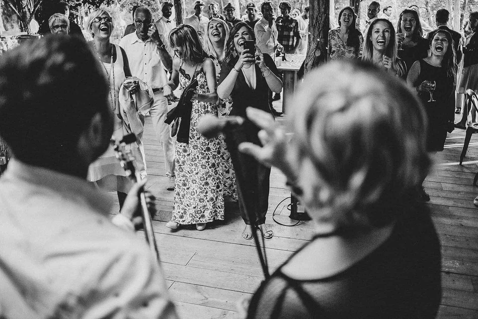 people singing in a barn wedding
